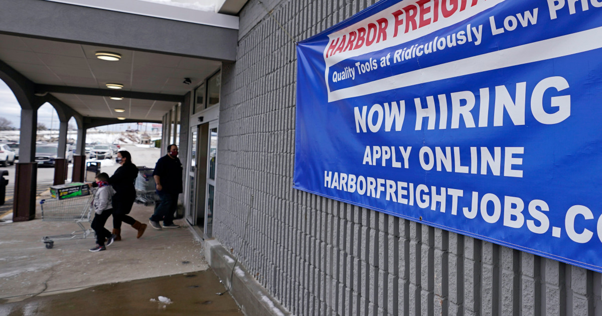 US jobless claims fall slightly but still remain high at 900,000